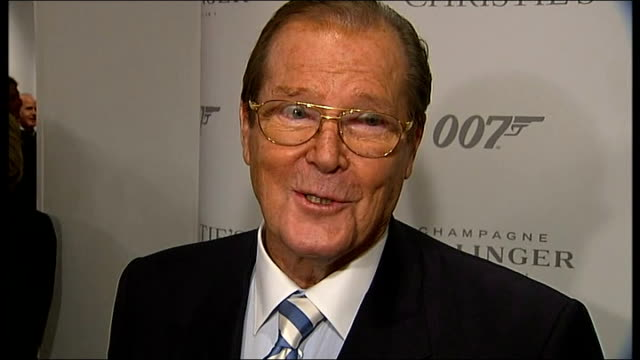 vídeos de stock, filmes e b-roll de james bond 50th anniversary celebrated christie's int sir roger moore interview sot - james bond trabalho conhecido