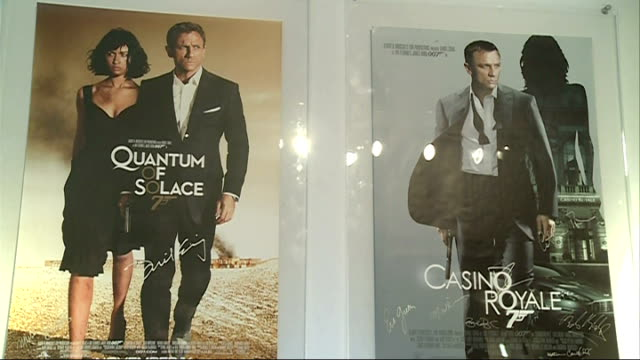 james bond 50th anniversary celebrated england london christie's int clothes from bond films on mannequins next to posters of james bond actors film... - casino poster stock videos & royalty-free footage