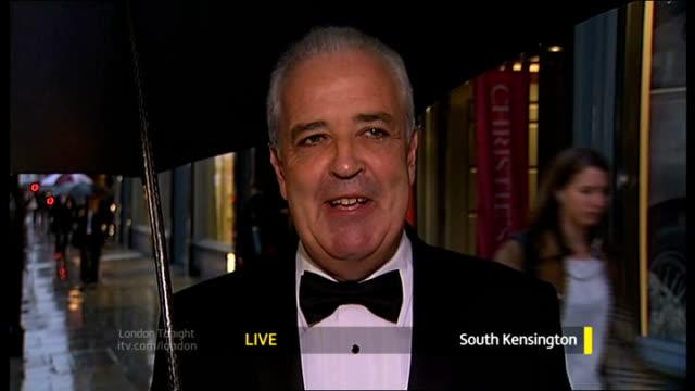 stockvideo's en b-roll-footage met james bond 50th anniversary celebrated england london ext hugh edmeades live 2way interview from south kensington sot - 50 jarig jubileum