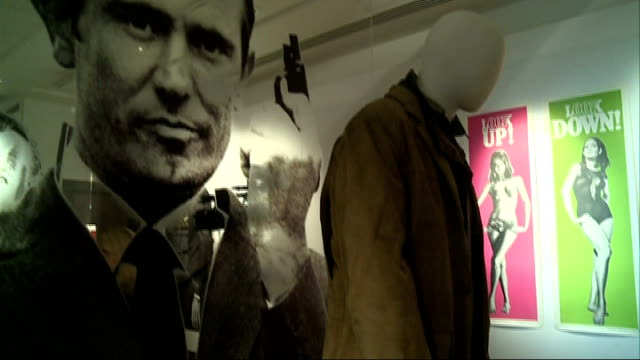 james bond 50th anniversary celebrated; various shots of james bond posters and clothes on display watches and earrings signed james bond poster... - swimming trunks stock videos & royalty-free footage
