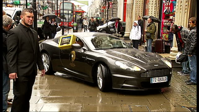 james bond celebrates 50 years since first film england london oxford street photography** car along with britt ekland holding golden briefcase out... - bond girl fictional character stock videos & royalty-free footage