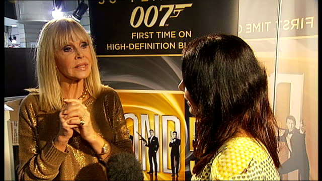 james bond celebrates 50 years since first film int britt ekland interview with reporter in shot sot - bond girl fictional character stock videos & royalty-free footage