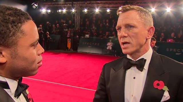 james bond film 'spectre' film premiere red carpet interviews england london kensington royal albert hall unidentified man and woman on red carpet /... - daniel craig actor stock videos and b-roll footage