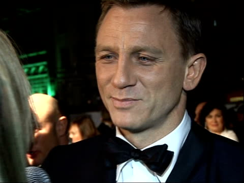 James Bond 'Quantum of Solace' premiere in London Red carpet arrivals and interviews **Music heard SOT Daniel Craig speaking to press SOT / back view...
