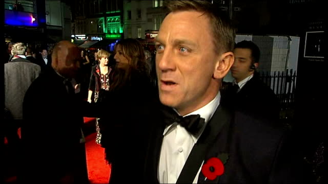 James Bond 'Quantum of Solace' premiere in London Red carpet interviews Daniel Craig interview with girlfriend Satsuki Mitchell briefly in shot SOT...
