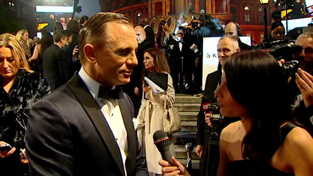 james bond 'skyfall' premiere arrivals and interviews red carpet as people arrive / craig towards on red carpet and stopping to speak to itn reporter... - daniel craig stock videos and b-roll footage