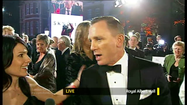 james bond 'skyfall' premiere england london royal albert hall daniel craig live interview on red carpet with reporter in shot sot - skyfall stock videos and b-roll footage