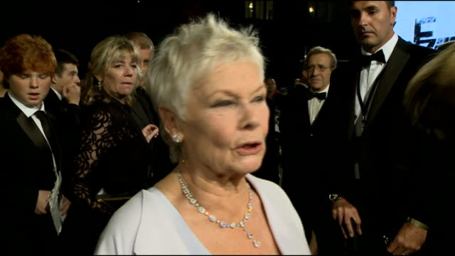 james bond 'skyfall' released r23101213 / england london royal albert hall ext judi dench interview sot - skyfall 2012 film stock videos and b-roll footage