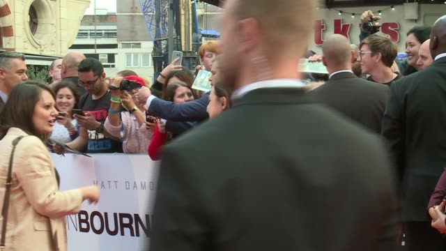 jason bourne premiere red carpet interviews **music heard sot** julia stiles chatting to press / matt damon posing for selfies and signing autographs... - julia stiles stock videos and b-roll footage