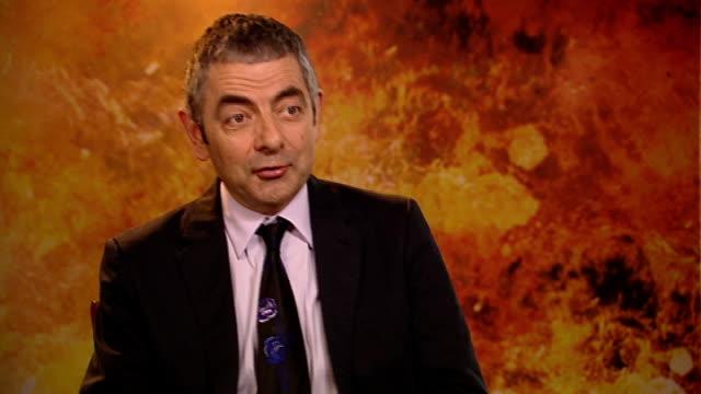 'johnny english reborn': rowan atkinson interview; england: london: int rowan atkinson interview sot - didn't really miss playing characters but... - rowan atkinson stock videos & royalty-free footage