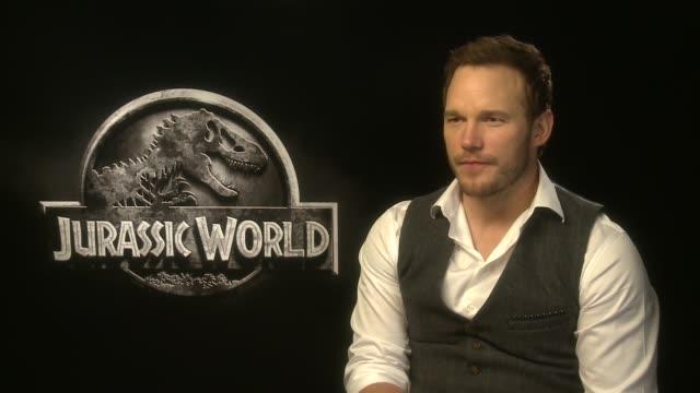 'jurassic world' junket interviews england london int chris pratt interview sot - chris pratt actor stock videos and b-roll footage
