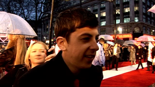 'kick ass' london premiere red carpet interviews christopher mintzplasse interview sot on how hit girl is clearly the most popular with fans my... - kick ass film title stock videos & royalty-free footage