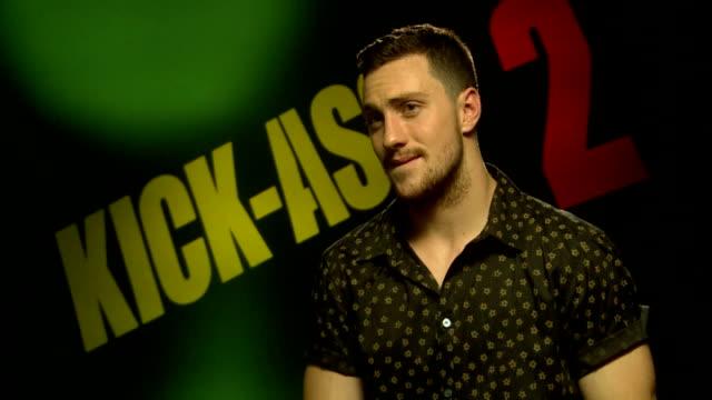 'kickass 2' aaron taylorjohnson junket interview england london int aaron taylorjohnson interview sot - kick ass film title stock videos & royalty-free footage