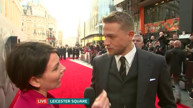 legend of the sword' london premiere; charlie hunnam live interview sot - on dangers of using swords / on david beckham cameo - cameo brooch stock videos & royalty-free footage