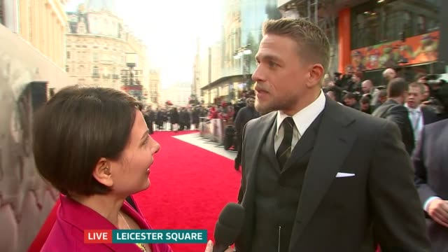 legend of the sword' london premiere; charlie hunnam live interview sot - on how professional david beckham was - on being from newcastle via america - バンド アメリカ点の映像素材/bロール