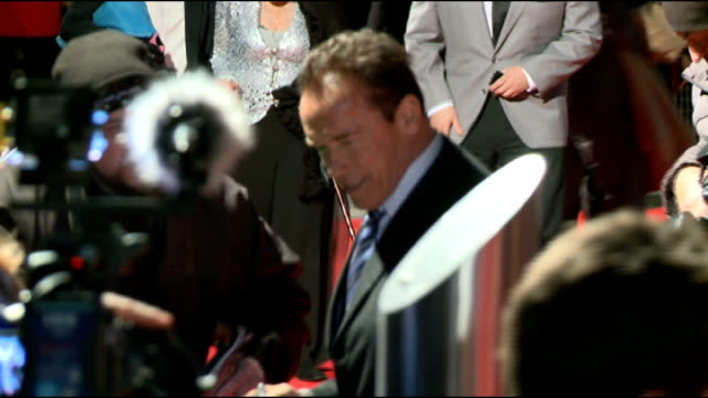 'last stand' london film premiere: arnold schwarzenegger interview; england: london: ext/night various arnold schwarzenegger signing autographs for... - arnold schwarzenegger stock-videos und b-roll-filmmaterial