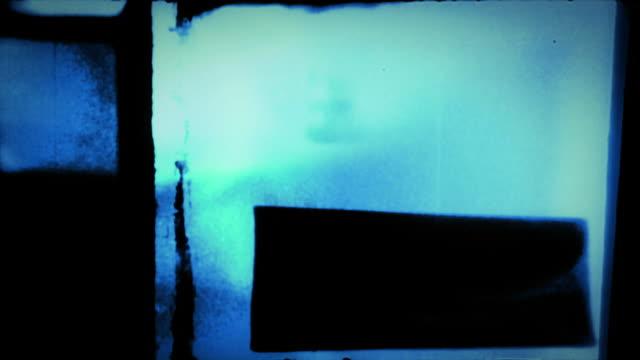 stockvideo's en b-roll-footage met film leader with water damage, pulsing colors and sprocket holes (loop). - sprocket