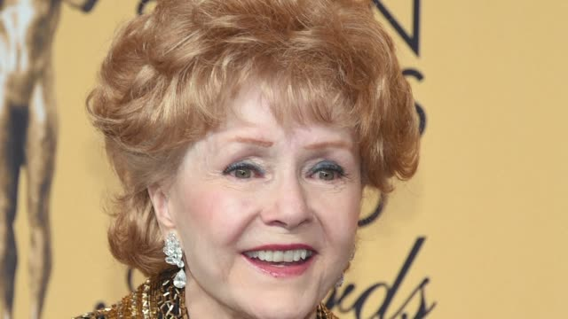 film legend debbie reynolds was rushed to hospital wednesday after suffering a possible stroke a day after the death of her movie star daughter... - debbie reynolds stock-videos und b-roll-filmmaterial