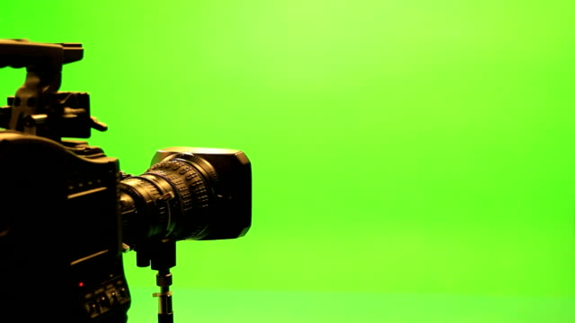 film lens with a green screen. - video recorder stock videos & royalty-free footage