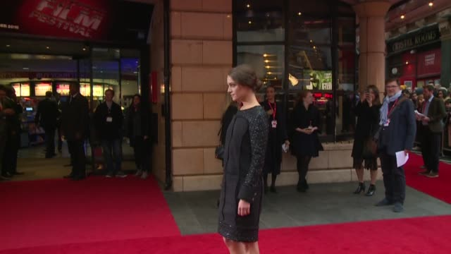 lobster premiere: red carpet arrivals and interviews; england: london: ext crows and 'the lobster' posters / yorgos lanthimos posing for press /... - colin farrell stock videos & royalty-free footage