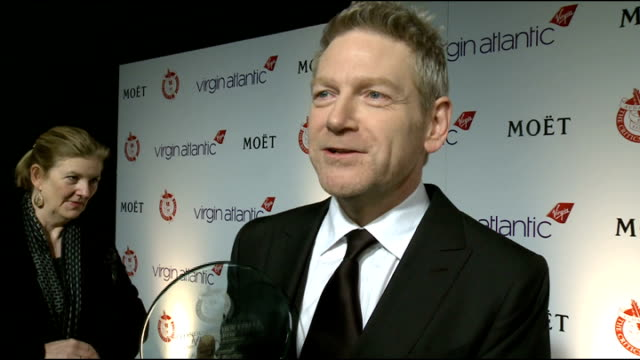 london critics' circle film awards 2012 arrivals int kenneth branagh photocall holding 'best supporting actor' trophy and interview sot - best supporting actor stock videos & royalty-free footage