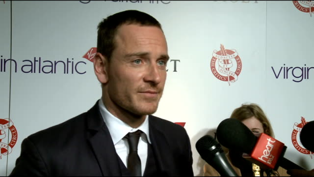 london critics' circle film awards 2012: arrivals; michael fassbender photocall holding 'best british actor' trophy and interview sot olivia colman... - film award type stock videos & royalty-free footage
