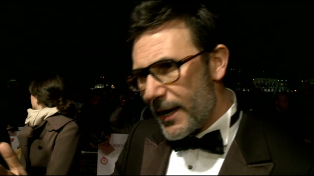 London Critics' Circle Film Awards 2012 arrivals Michel Hazanavicius talking to press on red carpet and interview SOT discusses his film 'The Artist/...