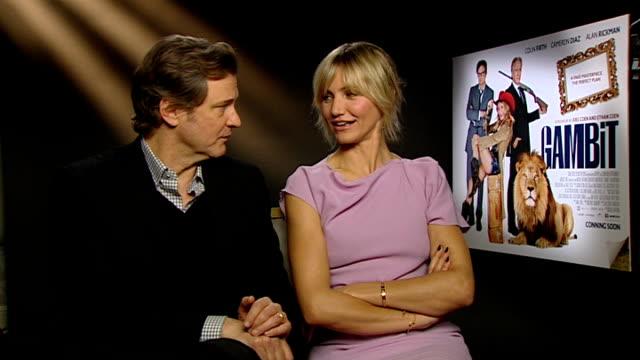 vídeos de stock, filmes e b-roll de london premiere of 'gambit' int colin firth interview sot encounter with drunk woman revolving door strange intimacy - colin firth