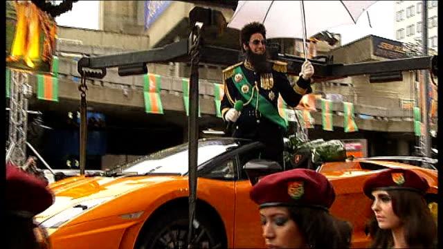 london premiere of 'the dictator'; england: london: royal festival hall: ext **flash photography throughout ** sacha baron cohen arriving on car... - ロイヤルフェスティバルホール点の映像素材/bロール