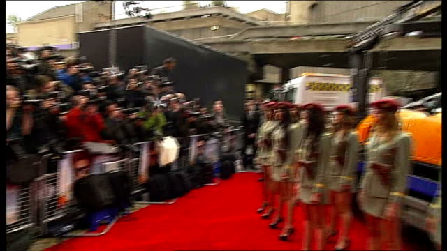 london premiere of 'the dictator'; press photographers baron cohen on car with women in military uniforms standing in front - premiere event stock videos & royalty-free footage