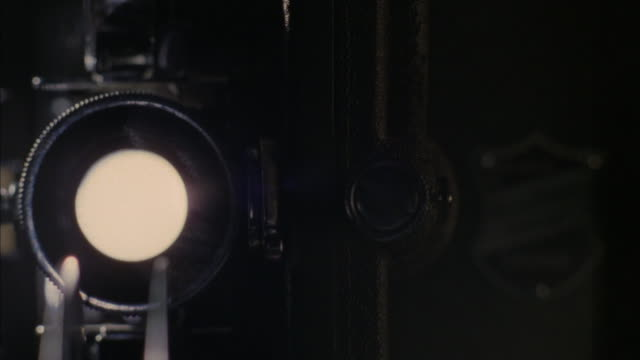 film loops through a projector. - projection equipment stock videos & royalty-free footage
