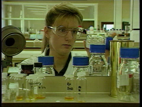 'Lorenzo's Oil' premiere ENGLAND Technician in lab Oil being stirred in lab beaker Close shot oil in centrifuge