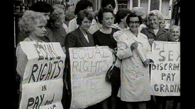 'made in dagenham' film premiere tx england london westminster ext group of dagenham women factory workers demonstrating holding placards for equal... - dagenham stock videos & royalty-free footage