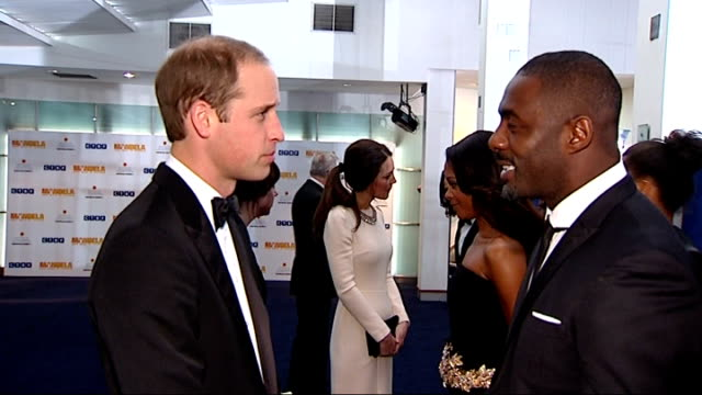 'Mandela Long Walk to Freedom London premiere Duke and Duchess of Cambridge arrival Idris Elba and Naomie Harris chatting to William and Kate / Kate...