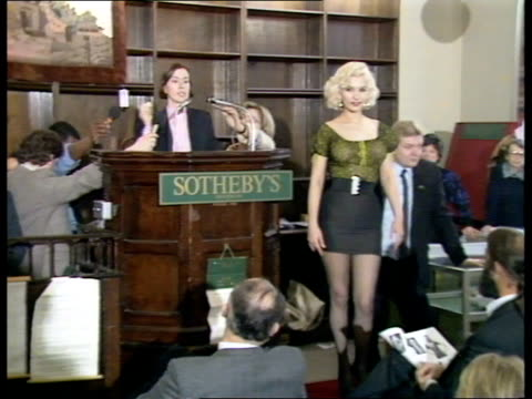 marilyn monroe blouse auction england london sothebys cms model kay kent modelling marilyn monroe's green blouse stands posing as auctioneer in b/g... - blouse stock videos & royalty-free footage