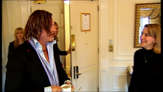 mickey rourke interview on 'the wrestler' england london int mickey rourke arriving in room with others and chatting to itn reporter stephanie west... - mickey rourke actor stock videos & royalty-free footage