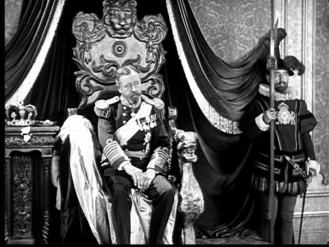 1924 b&w film montage ws king on throne with guests on each side/ ms man kissing king's hand  - respect stock videos and b-roll footage