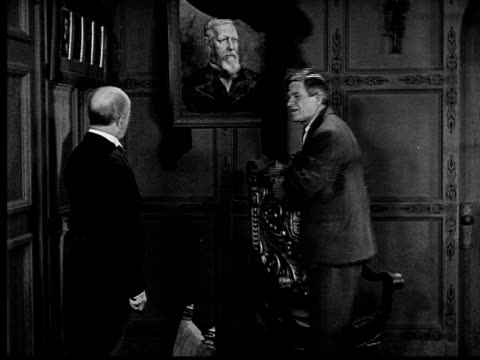 1924 b&w film montage ms man asking butler about portait of man in fancy home/ title card concerning assassinated ambassador/ man and butler  - 1924 stock-videos und b-roll-filmmaterial