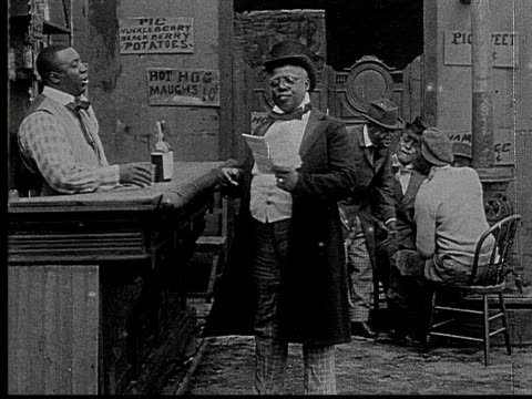 1916 B&W MS Film montage man in top hat talking to bartender/ bartender handing man newspaper/ CU newspaper headline about gambling/ man gesturing to bartender and laughing