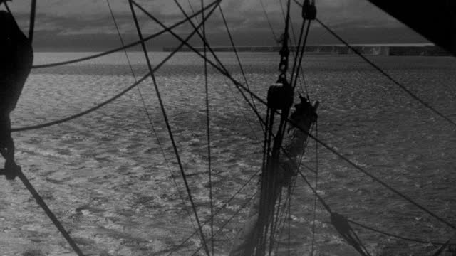 film montage of ice floating in sea, chunks of ice drifting past bow of sailing ship during richard e. byrd's first antarctic expedition - 1935 stock videos & royalty-free footage