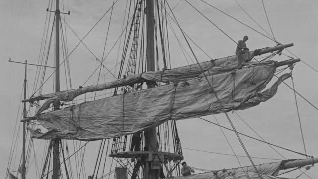 film montage of sailing ship moving in sea, men working on sailing ship moving in sea, ice floating near bow of sailing ship in sea during richard e. byrd's first antarctic expedition - 1935 stock videos & royalty-free footage