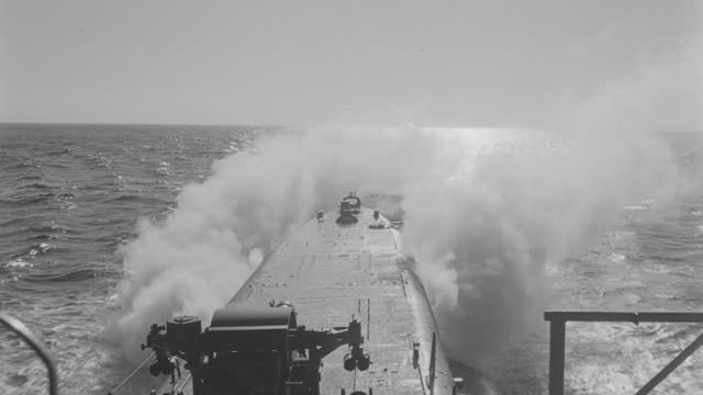film montage of submarine emerging from sea, submarine lays smoke screen as it sailing in sea - surfacing stock videos & royalty-free footage
