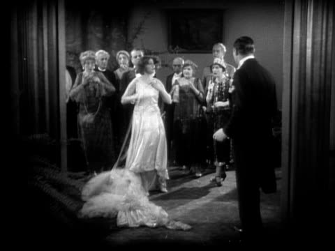 1928 b/w film montage wide shot bride yelling at groom as she tears off her wedding dress/ wide shot bride running for doors  - lingerie stock videos & royalty-free footage