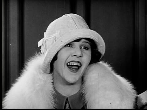 1924 b&w film montage cu young woman laughing/ young woman getting up and following mother and father woth father looking displeased in top hat  - 1924 stock videos and b-roll footage