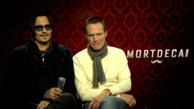 'Mortdecai' Johnny Depp and Paul Bettany interview ENGLAND London INT Johnny Depp and Paul Bettany interview SOT Reporter taking 'selfie' photograph...