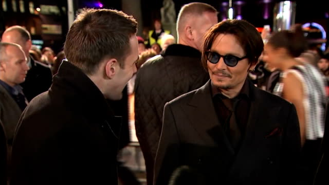 'Mortdecai' premiere Depp and Bettany interviews ENGLAND London leicester Square Johnny Depp interview SOT Talks of his character and the accent /...