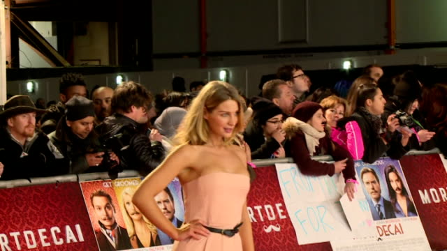 'Mortdecai' premiere Red carpet arrivals Olivia NewmanYoung posing