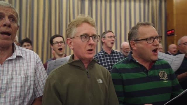 crouch end choir provides backing vocals for sir elton john biopic 'rocketman' england london crouch end int **music heard sot** brief shot of crouch... - 伝記映画点の映像素材/bロール