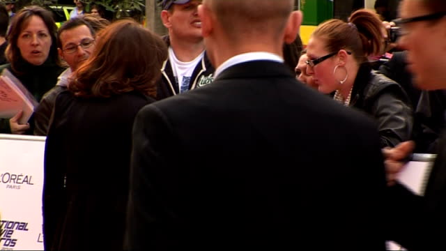 national movie awards 2010: red carpet arrivals; claudia winkleman arrival michelle ryan interview sot - on dream role/ on eastenders - no way she... - クラウディア ウィンクルマン点の映像素材/bロール