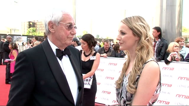 national movie awards 2011 red carpet arrivals england london wembley arena ext barry norman posing / barry norman interview with reporter in shot... - barry norman stock videos & royalty-free footage